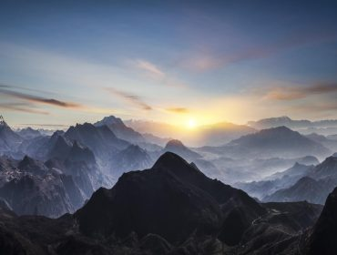 Aerial view of misty mountains at sunrise
