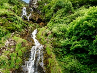 Beautiful water cascade of Powerscourt Waterfall, the highest waterfall in Ireland. Famous tourist atractions in co. Wicklow, Ireland. Near Powerscourt Manor House.