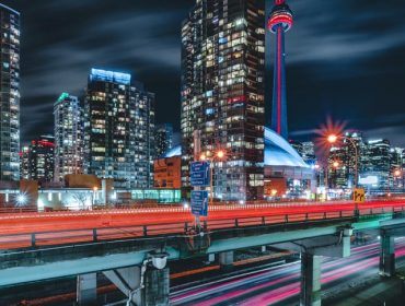 Epic futuristic and modern skyline views of downtown Toronto with the Gardiner Highway leading your eye to office buildings and condominiums.